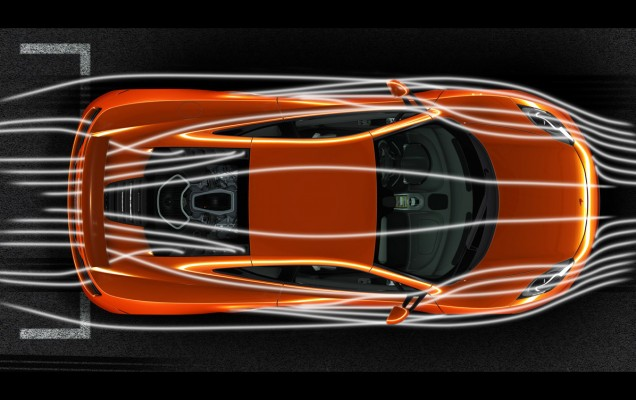 The McLaren MP4-12C undergoes wind-tunnel testing with airflow visualization.