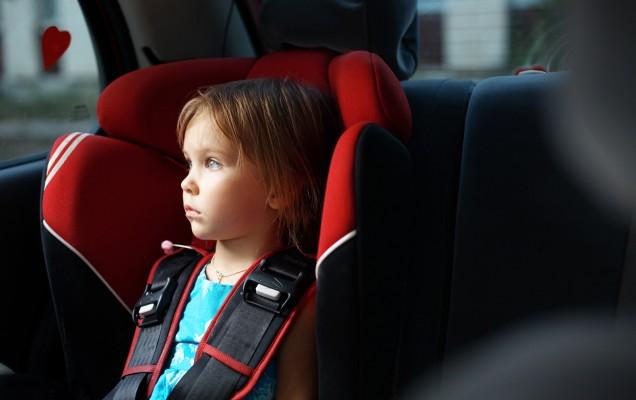bigstock-Child-in-auto-baby-seat-in-car-12137609