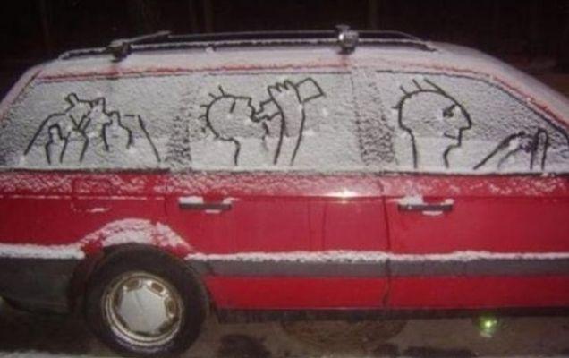 funny-snow-art-on-car-550x396